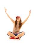 sittande tonåring för golv arkivbild