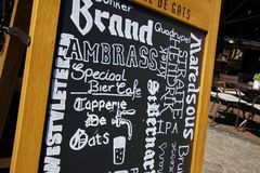 SITTARD, NETHERLANDS - JUIN 29. 2019: Close up of hand written menu on black chalk board of durch restaurant royalty free stock photo