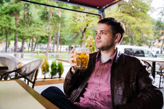 Sitted and relaxed man with a beer in peace Royalty Free Stock Photo