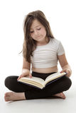 Sittign quietly reading Royalty Free Stock Image