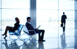 Sitting in airport Stock Photo
