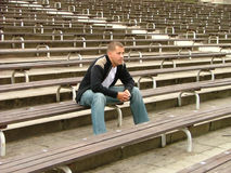 Sitting alone. Young man sitting alone Royalty Free Stock Photos