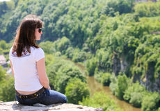Sitting Alone At The Top Of The Precipice Stock Image