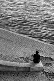 Sitting along the Seine, Paris Stock Photography