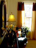 Sitting area. Chair in sunny window in bedroom Stock Photo