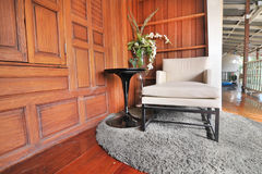 Sitting area on balcony in the asian wooden house style Stock Image