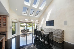 Sitting area with skylights and pool view Royalty Free Stock Photography