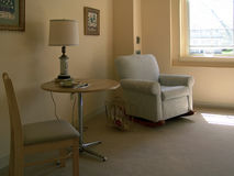 Sitting area in sunlight. Sitting area in assisted living apartment, muted tones, living room, muted tones Royalty Free Stock Photography