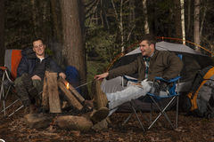 Sitting around the camp fire Royalty Free Stock Photography