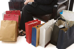 Sitting arround shopping bags Royalty Free Stock Images
