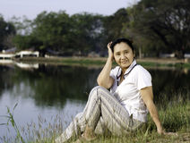 Sitting woman by the lake Royalty Free Stock Photo