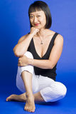 Sitting Asian Woman with Short Hair and Smiling Stock Photo