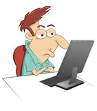 Sitting At His Computer Royalty Free Stock Photography