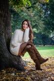 Sitting autumn girl Stock Image