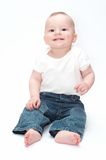 Sitting baby. Smiling baby sitting on the floor royalty free stock photo