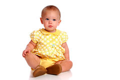 Sitting Baby Facing Camera. Baby sitting on white background Royalty Free Stock Photos