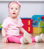Sitting baby girl Royalty Free Stock Photos