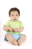 Sitting baby in lime and aqua Royalty Free Stock Image