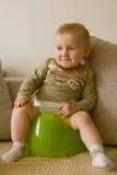 Sitting baby on potty. Sitting baby on green potty stock photo
