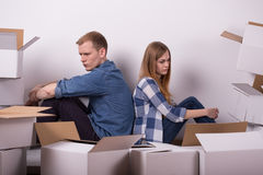 Sitting back to back. Offended girlfriend and boyfriend sitting back to back Royalty Free Stock Images