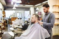 Sitting in barbershop Stock Photos