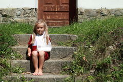 Sitting barefeet girl on the stairs Royalty Free Stock Images