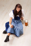 Sitting bavarian girl Stock Photography