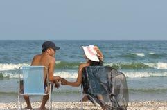 Sitting on beach Stock Photo