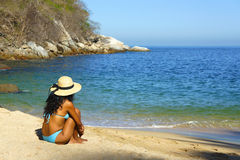 Sitting at the beach Stock Photography