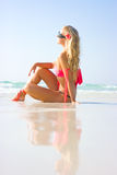 Sitting on the beach. Blonde girl sitting on the summer beach Royalty Free Stock Photos