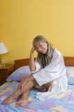 Sitting on the bed smiling Stock Photos