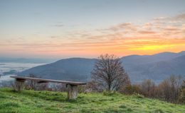 Sitting bench with sun rising Stock Images