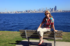 Sitting on a bench with a view of Seattle skyline. Royalty Free Stock Image