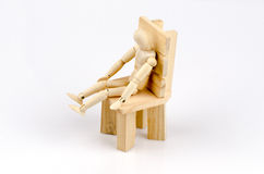Sitting bent.and Lifted his foot down. Royalty Free Stock Image