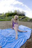 Sitting on blanket purple Stock Image