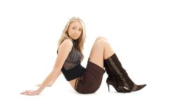 Sitting blond in brown shorts and boots #2 Stock Images