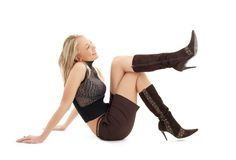 Sitting blond in brown shorts and boots #3 Royalty Free Stock Image