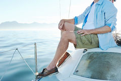 Sitting on boat man Royalty Free Stock Photos
