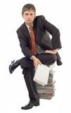 Sitting on book pile Stock Image