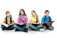 Sitting with books. Educational theme: group of teenagers sitting together and reading books stock photography
