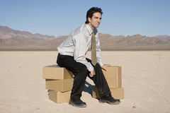 Sitting on boxes Stock Photos