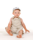 Sitting boy. With a cap Stock Photos