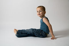 Sitting boy. Portrait of a cure sitting boy Royalty Free Stock Photography