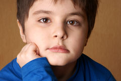 thoughtful little boy Stock Photo