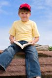 Sitting Boy with Book Royalty Free Stock Images