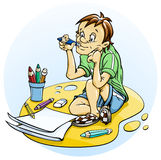Sitting boy draw pencil Stock Images