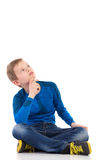 Sitting boy looking up Royalty Free Stock Photography