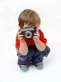 Sitting boy and photo camera Stock Photos