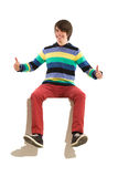 Sitting boy with thumbs up Royalty Free Stock Photography