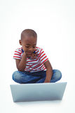 Sitting boy using laptop Stock Images